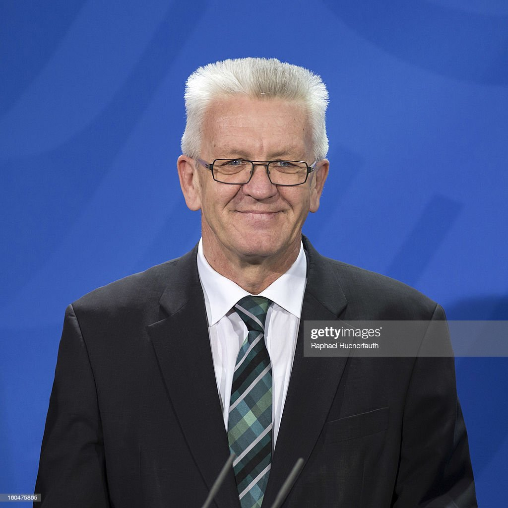 <a gi-track='captionPersonalityLinkClicked' href=/galleries/search?phrase=Winfried+Kretschmann&family=editorial&specificpeople=7227897 ng-click='$event.stopPropagation()'>Winfried Kretschmann</a> (L), Minister-president of Baden-Wuerttemberg and German Chancellor Angela Merkel (unseen) arrives at the Federal Chancellery for the presentation of the new Baden-Wuerttemberg 2 Euro coin, on February 01, 2013 in Berlin, Germany. Germany began issuing 2--euro commemorative coins in 2006, with each devoted to a federal state.
