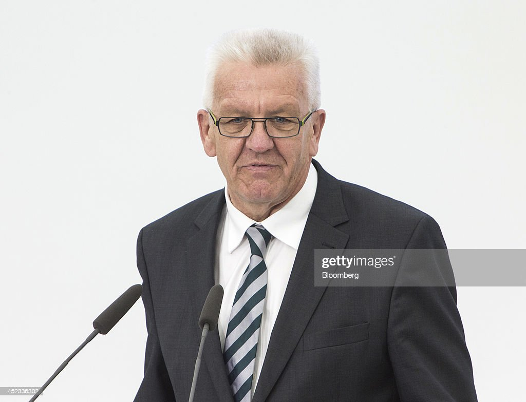 <a gi-track='captionPersonalityLinkClicked' href=/galleries/search?phrase=Winfried+Kretschmann&family=editorial&specificpeople=7227897 ng-click='$event.stopPropagation()'>Winfried Kretschmann</a>, the prime minister of Baden-Wuerttemberg state, speaks during a presentation to announce the expansion of Porsche AG's research and development center in Weissach, Germany on Friday, July 18, 2014. Porsche, the maker of the 911 sports car, plans to increase headcount by about 24 percent to underpin its growth ambitions. Photographer: Martin Leissl/Bloomberg via Getty Images