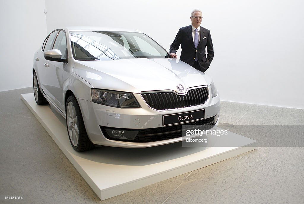 Winfried Vahland, chief executive officer of Skoda Auto AS, the Czech unit of Volkswagen AG, stands alongside a Skoda Octavia automobile, ahead of the results news conference in Mlada Boleslav, Czech Republic, on Wednesday, March 20, 2013. Volkswagen AG's Czech brand Skoda said it's 'fundamentally' confident that 2013 deliveries will rise as the introduction of a new Octavia small car version and Spaceback hatchback more than offsets a drop in European demand. Photographer: Martin Divisek/Bloomberg via Getty Images