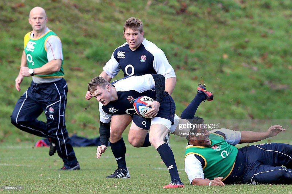 Wing Chris Ashton is tap tackled by prop Maka Vunipola during the England training session at Pennyhill Park on November 22, 2012 in Bagshot, England.