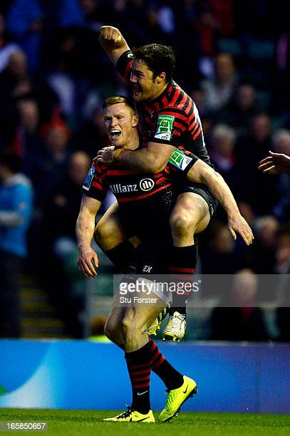 Wing Chris Ashton of Saracens is congratulated by teammate Brad Barritt after scoring his team's second try during the Heineken Cup quarter final...