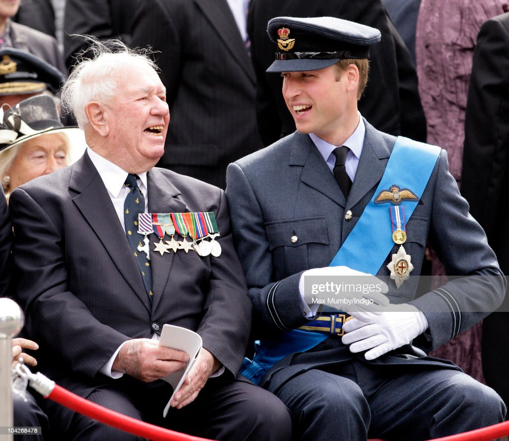 Wing Commander Bob Foster (retired) and <a gi-track='captionPersonalityLinkClicked' href=/galleries/search?phrase=Prince+William&family=editorial&specificpeople=178205 ng-click='$event.stopPropagation()'>Prince William</a>, Flight Lieutenant Wales watch the parade and flypast as they attend the Battle of Britain 70th Anniversary Service at Westminster Abbey on September 19, 2010 in London, England.