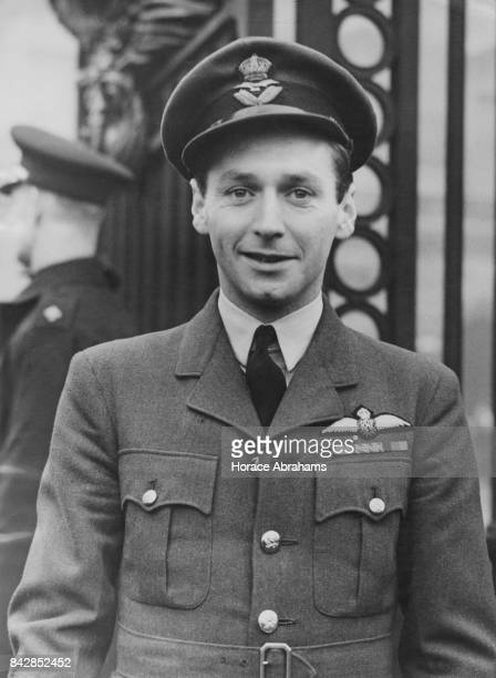 Wing Commander Raymond Hiley Harries of the RAF receives the DSO the DFC and Two Bars at Buckingham Palace London for his actions as a fighter pilot...