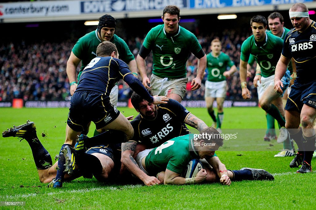 Wing Craig Gilroy of Ireland barges over to score the opening try during the RBS Six Nations match between Scotland and Ireland at Murrayfield...