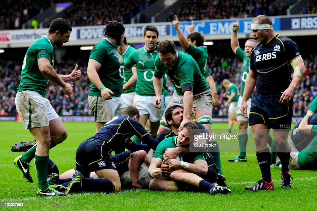 Wing <a gi-track='captionPersonalityLinkClicked' href=/galleries/search?phrase=Craig+Gilroy&family=editorial&specificpeople=7478446 ng-click='$event.stopPropagation()'>Craig Gilroy</a> of Ireland is congratulated by teammate Donnacha Ryan after scoring the opening try during the RBS Six Nations match between Scotland and Ireland at Murrayfield Stadium on February 24, 2013 in Edinburgh, Scotland.
