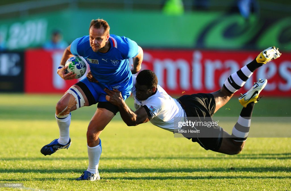 Wing Danie Dames of Namibia is tackled by Naipolioni Nalaga of Fiji during the IRB 2011 Rugby World Cup Pool D match between Fiji and Namibia at Rotorua International Stadium on September 10, 2011 in Rotorua, New Zealand.