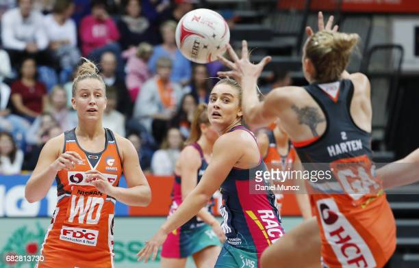 wing defence JamieLee Price passes the ball during the round 12 Super Netball match between the Giants and the Vixens at AIS on May 14 2017 in...