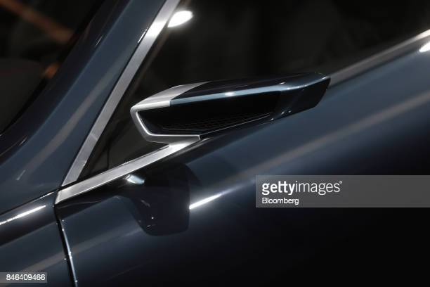 A wing mirror sits on a BMW 8 Series electric concept automobile manufactured by Bayerische Motoren Werke AG during the second media preview day of...