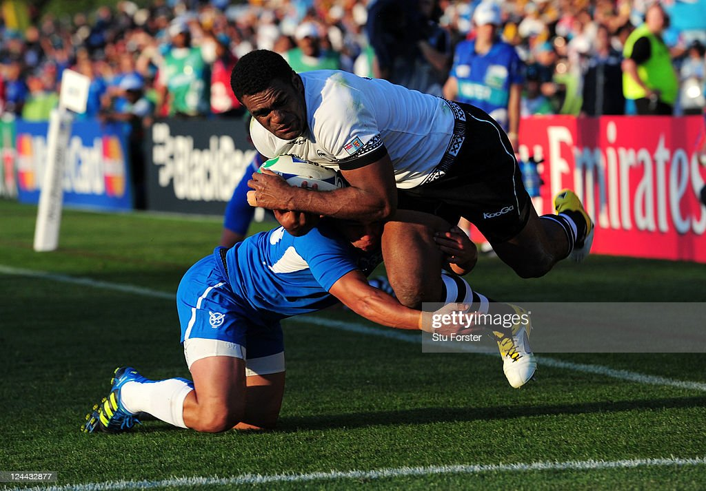 Wing Naipolioni Nalaga of Fiji bursts through the tackle from Ryan De La Harpe of Namibia to score his team's sixth try during the IRB 2011 Rugby World Cup Pool D match between Fiji and Namibia at Rotorua International Stadium on September 10, 2011 in Rotorua, New Zealand.