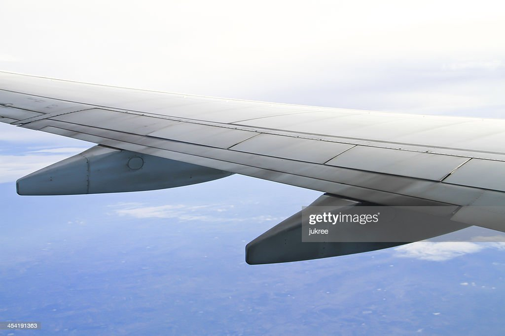 Wing of the plane on sky background : Stock Photo