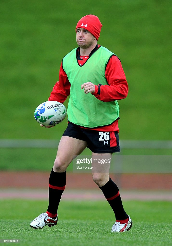 Wing <a gi-track='captionPersonalityLinkClicked' href=/galleries/search?phrase=Shane+Williams&family=editorial&specificpeople=206777 ng-click='$event.stopPropagation()'>Shane Williams</a> runs with the ball during a Wales IRB Rugby World Cup 2011 training session at Newtown Park on October 6, 2011 in Wellington, New Zealand.