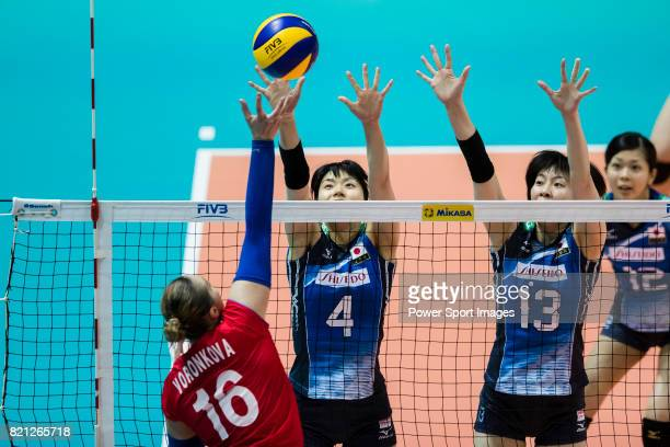 Wing spiker Risa Shinnabe of Japan and Middle blocker Mai Okumura of Japan block during the FIVB Volleyball World Grand Prix Hong Kong 2017 match...