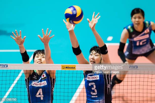 Wing spiker Risa Shinnabe of Japan and Middle blocker Nana Iwasaka of Japan block during the FIVB Volleyball World Grand Prix Hong Kong 2017 match...