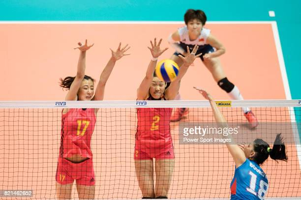 Wing spiker Ting Zhu of China blocks Opposite spiker Tijana Boskovic of Serbia during the FIVB Volleyball World Grand Prix match between China vs...