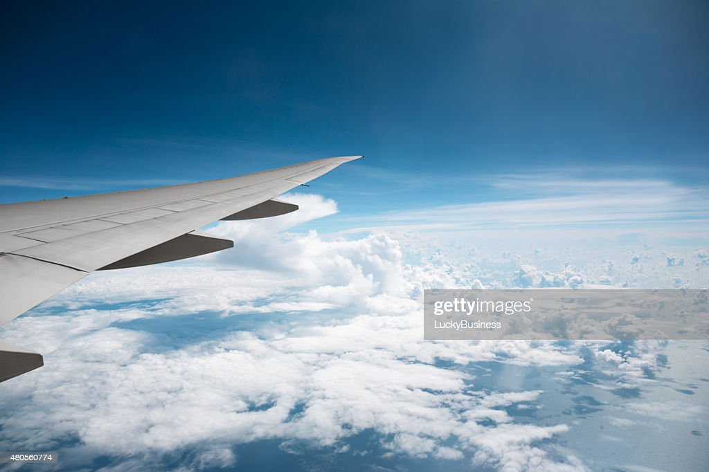 wing transport aircraft above the clouds : Stock Photo