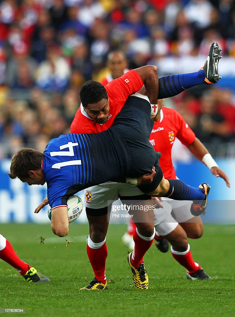 Wing <a gi-track='captionPersonalityLinkClicked' href=/galleries/search?phrase=Vincent+Clerc&family=editorial&specificpeople=235795 ng-click='$event.stopPropagation()'>Vincent Clerc</a> of France is upended in the tackle by Sukanaivalu Hufanga of Tonga during the IRB 2011 Rugby World Cup Pool A match between France and Tonga at Wellington Regional Stadium on October 1, 2011 in Wellington, New Zealand.