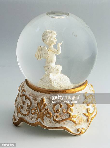 Winged cherub stand with baroque decoration snowglobe 20th century