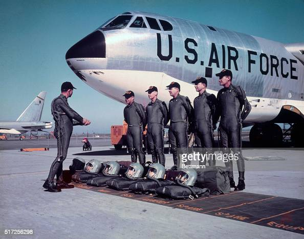 Winging its way over the West Coast during a training flight from Castle Air Force Base Calif Ground crew performs maintenance on a giant Boeing B52...
