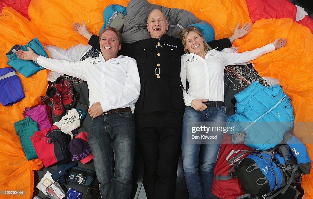 'Wings of Kilimajaro' founder and paragliding pilot Adrian Mcrae, Commisioner of Police for the City of London Adrian Leppard and adventurer Squash Falconer, pose for pictures with a paraglider and a full climbers kit, during the Launch of the 'Wings Of Kilimanjaro' charity appeal at the top of 30 St Mary Axe, widely known as 'The Gherkin' on November 8, 2012 in London, England. The group will make up a team of around 200 adventurers and 1,000 porters from around the world who plan to climb the summit of Mt Kilimanjaro in Tanzania, before paragliding down from its 5895 metre peak on January 29, 2013. The hope is to raise $1 Million USD for three individual charities; Plant with Purpose, The One Foundation and World Serve International.