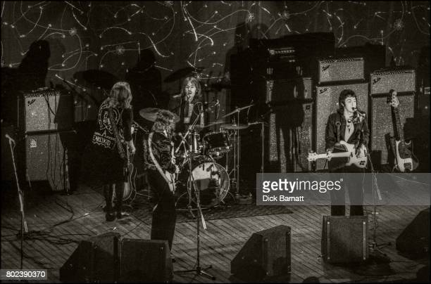 Wings performing on stage Hammersmith Odeon London 25th May 1973 LR Henry McCullough Denny Laine Denny Seiwell Paul McCartney