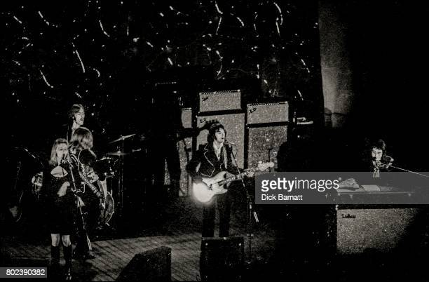 Wings performing on stage Hammersmith Odeon London 25th May 1973 LR Linda McCartney Henry McCullough Denny Seiwell Denny Laine Paul McCartney