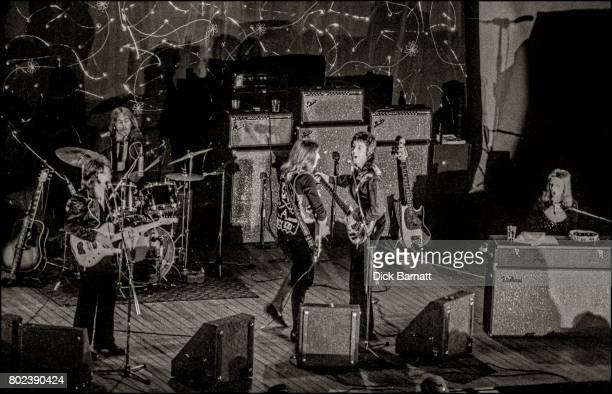 Wings performing on stage Hammersmith Odeon London 25th May 1973 LR Denny Laine Denny Seiwell Henry McCullough Paul McCartney Linda McCartney