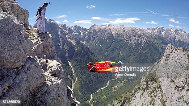 Wingsuit fliers descend from cliff summit