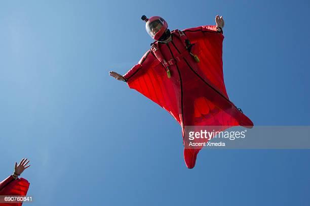 Wingsuit fliers endeavour to clasp hands