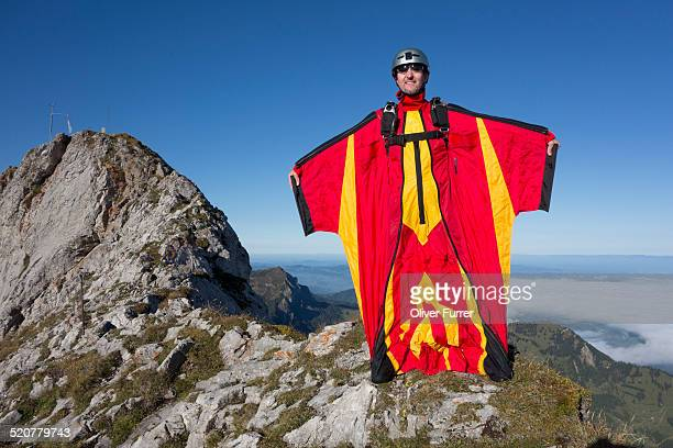 Wingsuit jumper is getting ready to jump down