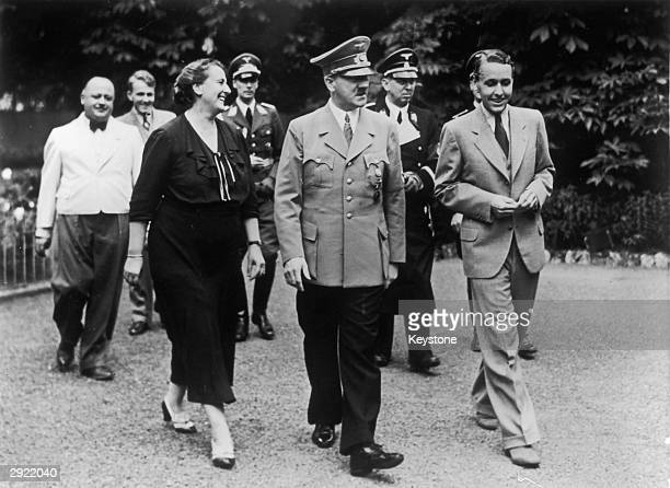 Winifred Wagner daughterinlaw of the German composer Richard Wagner with her son Wieland and German dictator Adolf Hitler in the garden at Wahnfried...