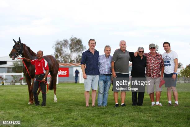 Wining owners pose Fontein Lad after winning Danny OâBrien MP BM64 Handicap at Stony Creek Racecourse on March 12 2017 in Stony Creek Australia