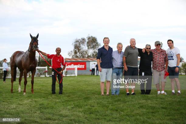 Wining owners pose with Fontein Lad after winning Danny OâBrien MP BM64 Handicap at Stony Creek Racecourse on March 12 2017 in Stony Creek Australia