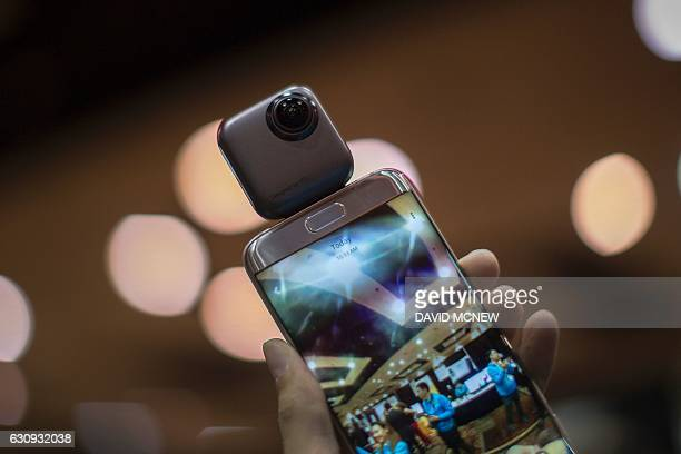 A Wink PTU 360degree spherical camera is shown with an Android phone during the 2017 Consumer Electronics Show in Las Vegas Nevada on January 3 2017...