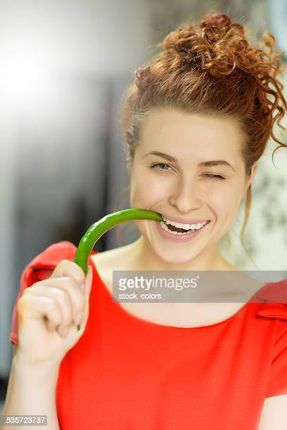 winking woman with jalapeno pepper