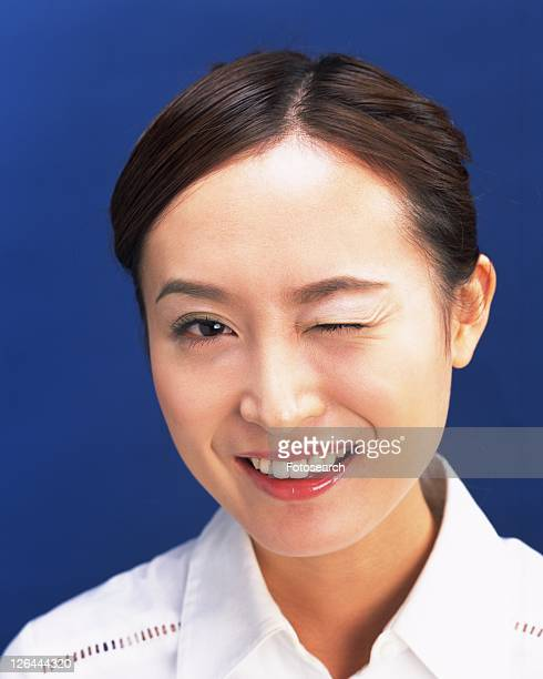 Winking Young Woman, Front View, Looking at Camera