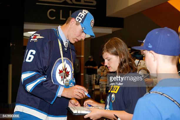 Winnepeg Jets Logan Stanley signs autographs after being selected 18th overall during round one of the 2016 NHL Draft on June 24 2016 in Buffalo New...