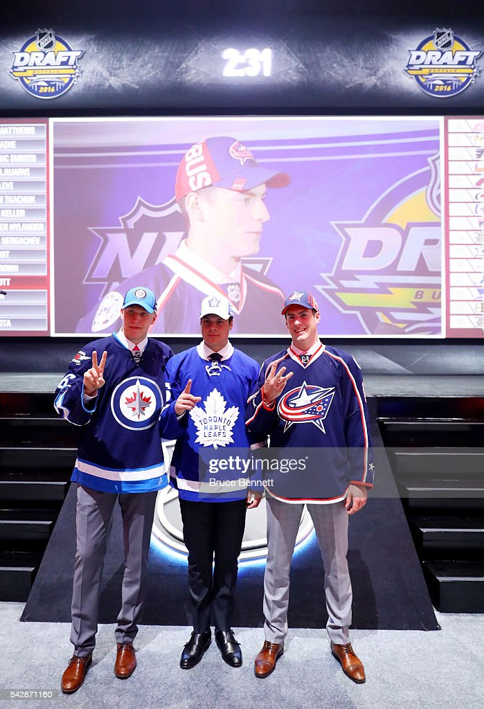 Winnepegs Jets second overall pick <a gi-track='captionPersonalityLinkClicked' href=/galleries/search?phrase=Patrik+Laine&family=editorial&specificpeople=13600427 ng-click='$event.stopPropagation()'>Patrik Laine</a>, Toronto Maple Leafs first overall pick <a gi-track='captionPersonalityLinkClicked' href=/galleries/search?phrase=Auston+Matthews&family=editorial&specificpeople=13452736 ng-click='$event.stopPropagation()'>Auston Matthews</a> and Columbus Blue Jackets third overall pick <a gi-track='captionPersonalityLinkClicked' href=/galleries/search?phrase=Pierre-Luc+Dubois&family=editorial&specificpeople=13636609 ng-click='$event.stopPropagation()'>Pierre-Luc Dubois</a> celebrate during round one of the 2016 NHL Draft on June 24, 2016 in Buffalo, New York.