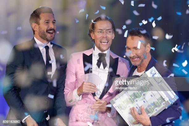 Winner 2017 Jens Hilbert celebrates next to the TV hosts Jochen Schropp and Jochen Bendel during the finals of 'Promi Big Brother 2017' at MMC Studio...