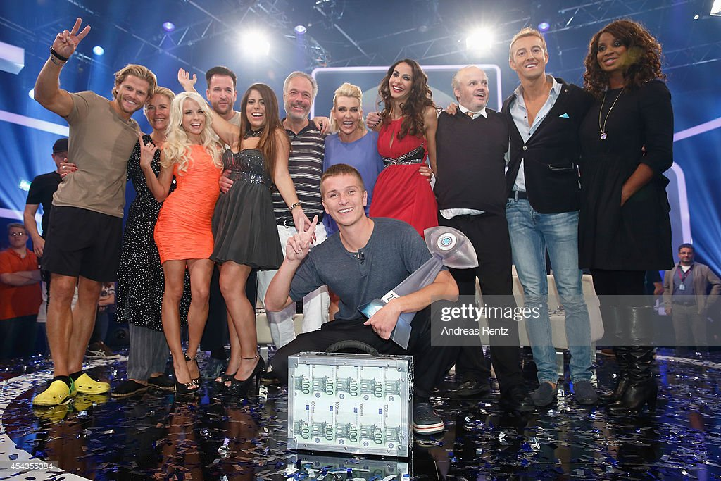 Winner Aaron Troschke poses with the award and final members at the Promi Big Brother finals at Coloneum on August 29 2014 in Cologne Germany