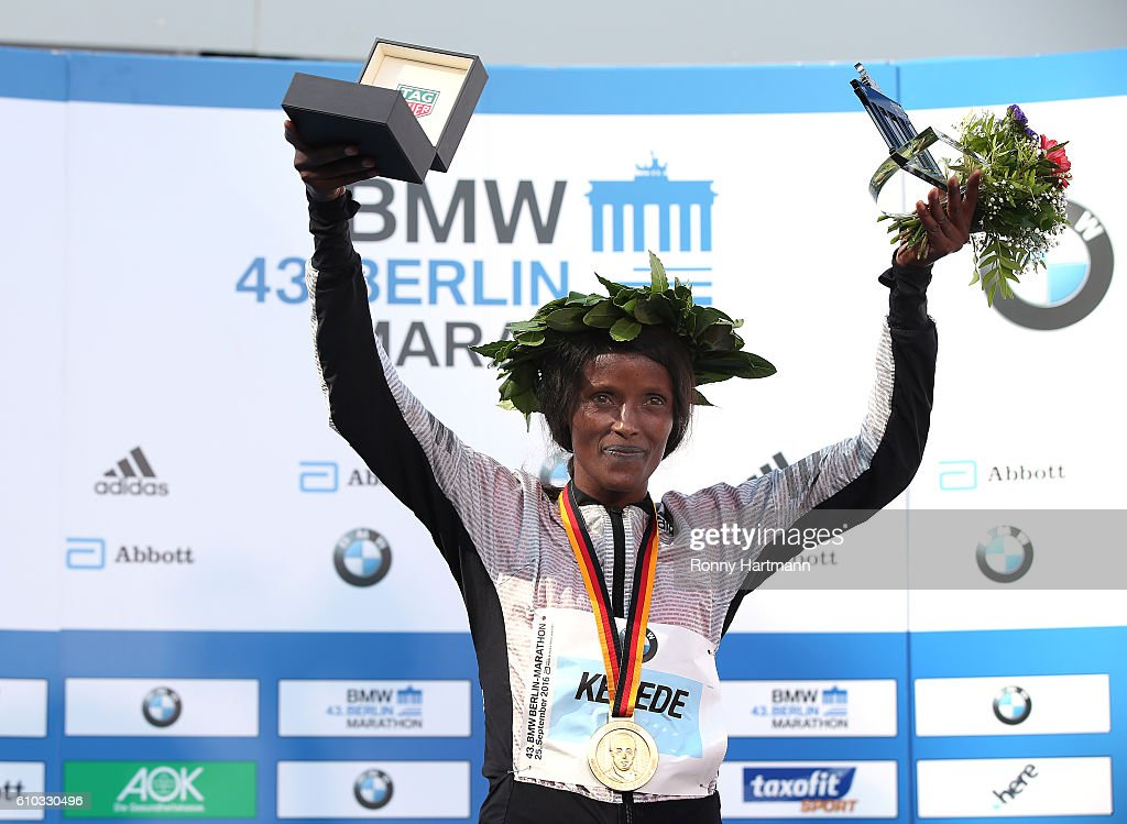 Winner Aberu Kebede of Ethiopia poses during the medal ceremony after the 43rd BMW Berlin Marathon on September 25, 2016 in Berlin, Germany.