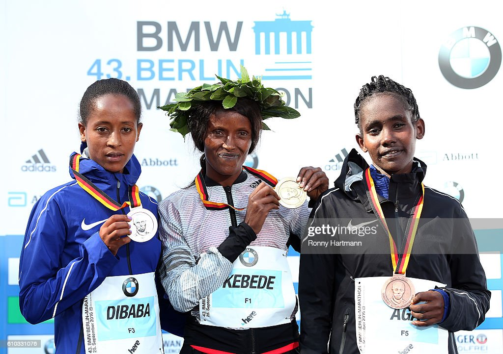 Winner Aberu Kebede (C) of Ethiopia, second placed Birhane Dibaba (L) of Ethiopia and third placed Ruto Aga of Ethiopia pose during the medal ceremony after the 43rd BMW Berlin Marathon on September 25, 2016 in Berlin, Germany.