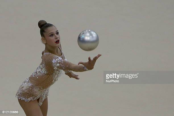Winner Aleksandra Soldatova of Russia performs with the ball during the final of the FIG Rhythmic Gymnastics World Cup in Lisbon Portugal on March 20...
