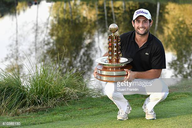 Winner Alexander Levy of France poses with the trophy as he celebrates after the final round of the Porsche European Open at Golf Resort Bad...