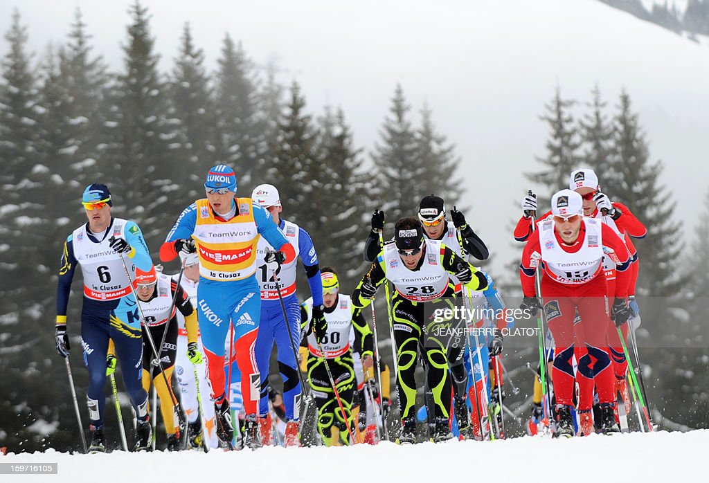 Winner Alexey Poltoranin of Kazakhstan (L) competes alongside other skiers during the men's World Cup Nordic skiing cross country 15km Mass Start race, on January 19, 2013, in La Clusaz,southern France. AFP PHOTO / Jean Pierre Clatot