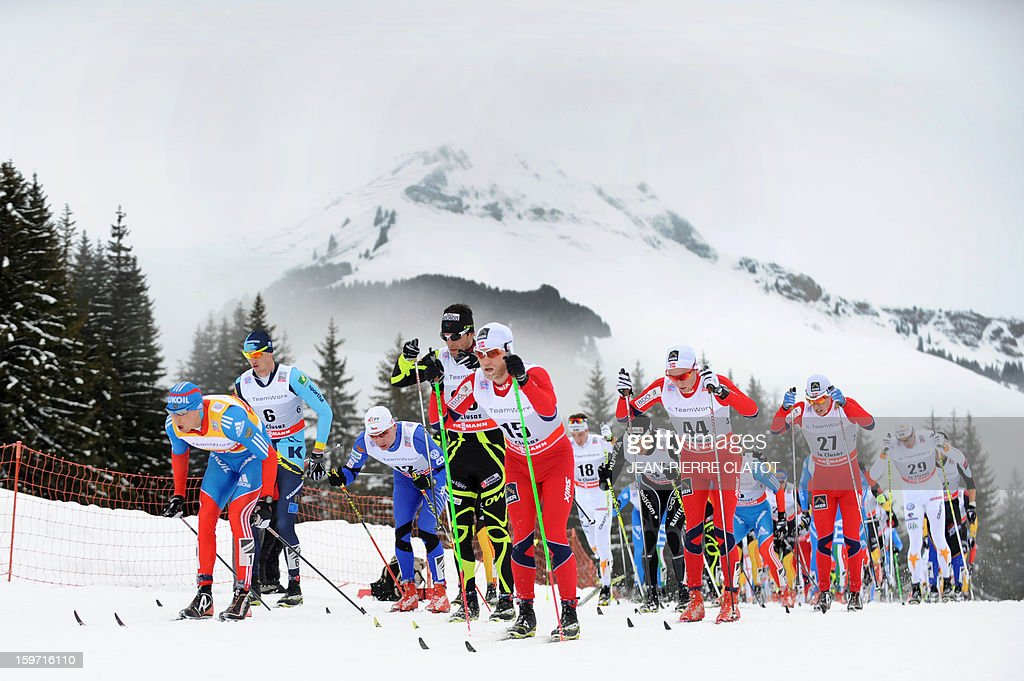Winner Alexey Poltoranin of Kazakhstan (2nd L) competes alongside other skiers during the men's World Cup Nordic skiing cross country 15km Mass Start race, on January 19, 2013, in La Clusaz,southern France. AFP PHOTO / Jean Pierre Clatot