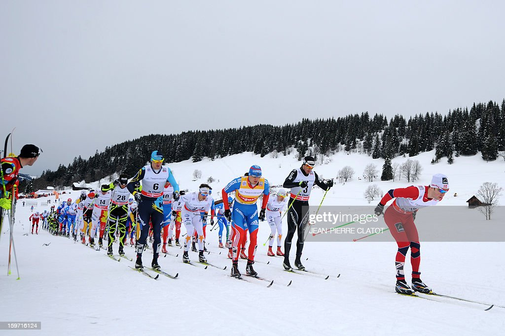 Winner Alexey Poltoranin of Kazakhstan (Front L) competes alongside other skiers during the men's World Cup Nordic skiing cross country 15km Mass Start race, on January 19, 2013, in La Clusaz,southern France. AFP PHOTO / Jean Pierre Clatot