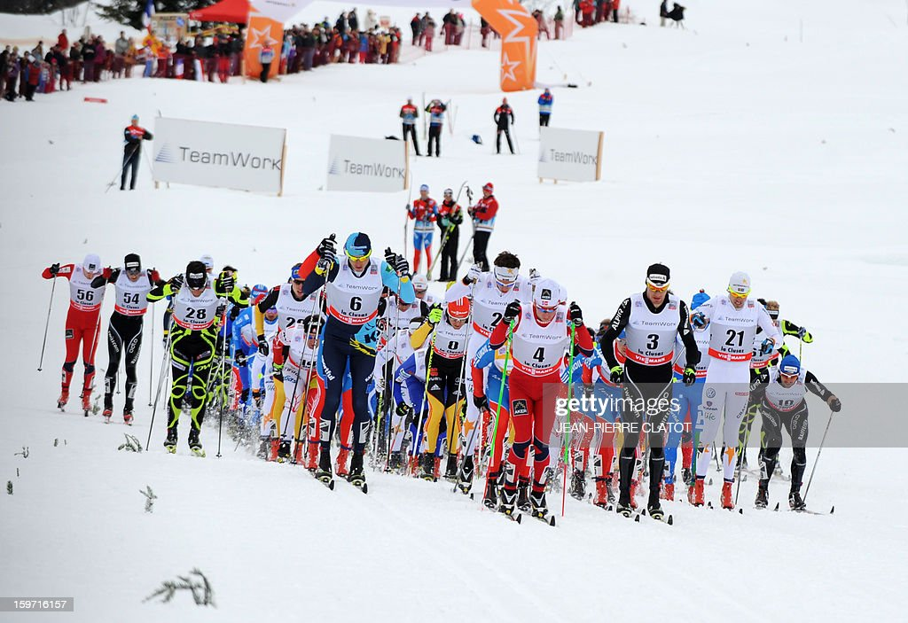 Winner Alexey Poltoranin of Kazakhstan (Front row L) competes alongside other skiers during the men's World Cup Nordic skiing cross country 15km Mass Start race, on January 19, 2013, in La Clusaz,southern France. AFP PHOTO / Jean Pierre Clatot