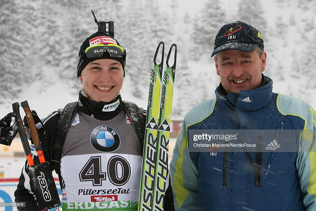 Winner <a gi-track='captionPersonalityLinkClicked' href=/galleries/search?phrase=Anastasiya+Kuzmina&family=editorial&specificpeople=6738529 ng-click='$event.stopPropagation()'>Anastasiya Kuzmina</a> of Slovakia and IBU race director Franz Berger of Austria smile to the camera after the women's sprint in the IBU Biathlon World Cup on December 10, 2010 in Hochfilzen, Austria.