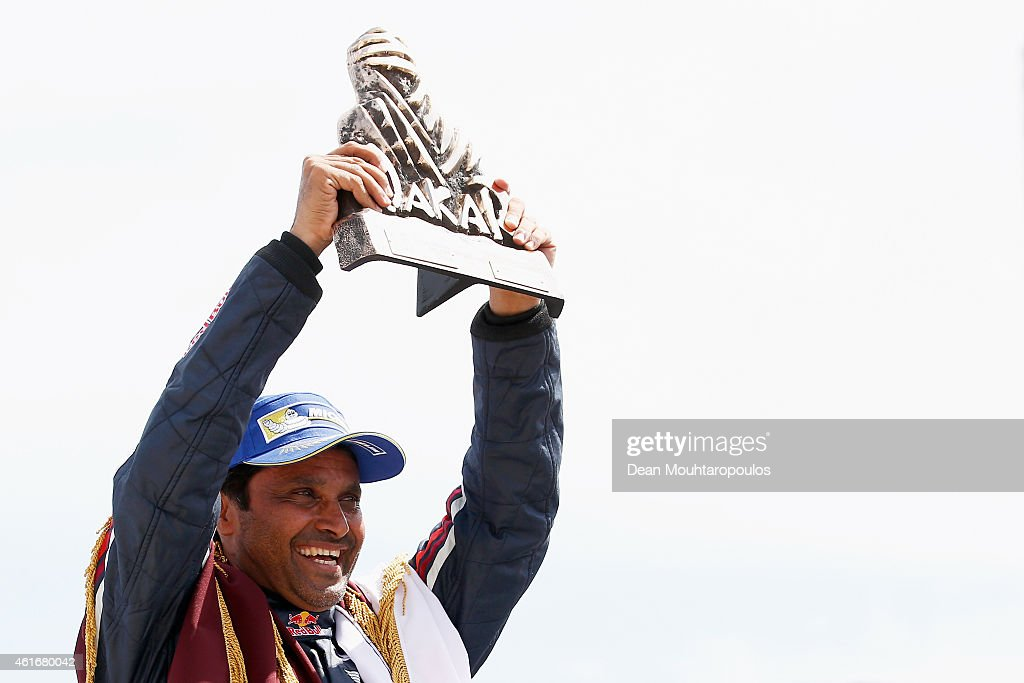 Winner and now Dakar champion, #301 Nasser Al Attiyah of Qatar and Mathieu Baumel (not in farme) of France for the ALL4 Racing Mini Qatar Rally Team celebrates the podium during Day 14 of the Dakar Rally at the Tecnopolis on January 17, 2015 in Buenos Aires, Argentina.