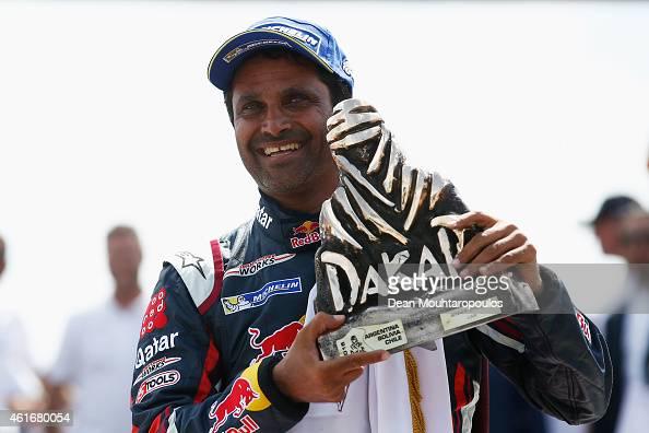 Winner and now Dakar champion #301 Nasser Al Attiyah of Qatar and Mathieu Baumel of France for the ALL4 Racing Mini Qatar Rally Team celebrates the...